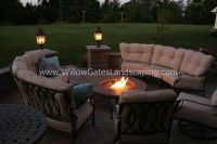 Paver patio with comfortable seating around gas fire pit ...