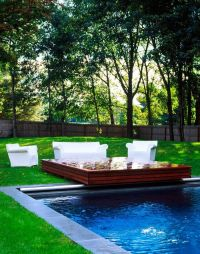 Novogratz country house backyard with pool deck ...
