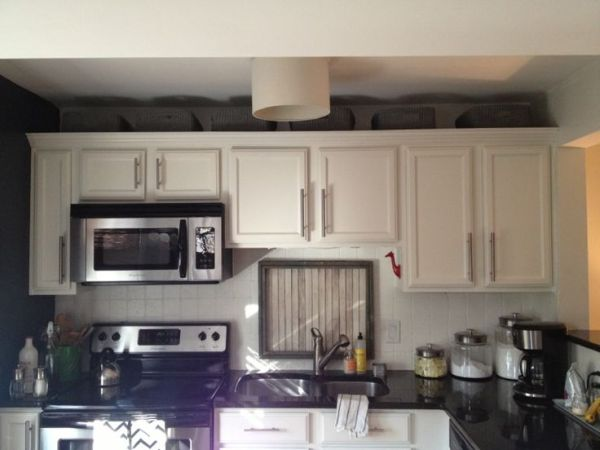 over kitchen cabinet storage Baskets above kitchen cabinets - cute and functional