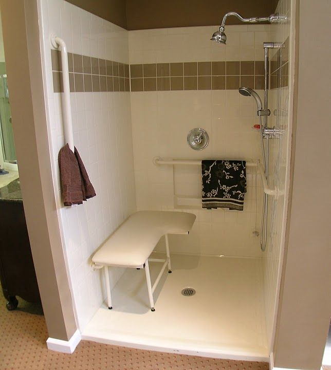 Accessible tile finish complete with seat grab bars and valve package Low threshold for