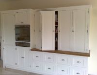bifold doors cabinet doors | Large storage cabinets, with ...