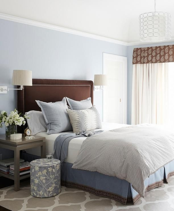 Sitting against gorgeous blue bedroom walls a brown