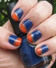 navy blue and orange nail