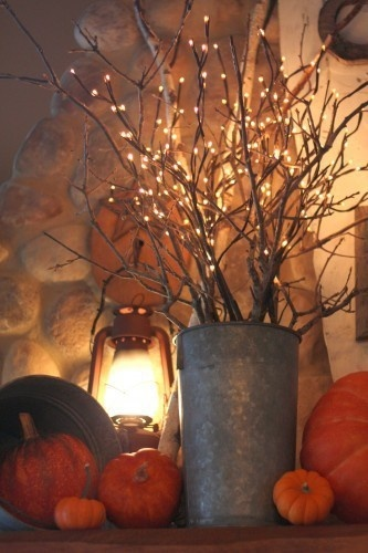 Love the ambience of lantern light in fall arrangements this year!