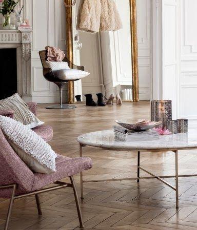 Chevron Wood Floors. Living Room. Gold. Pink. Mirror. Spacious. Apartment. Fireplace. Home. Decor. Design. Interior.
