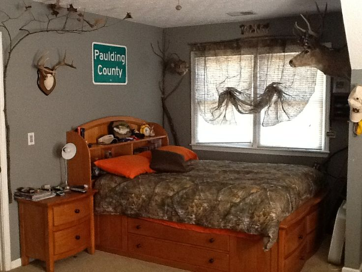 My sons redneck hunting bedroom with camo curtains