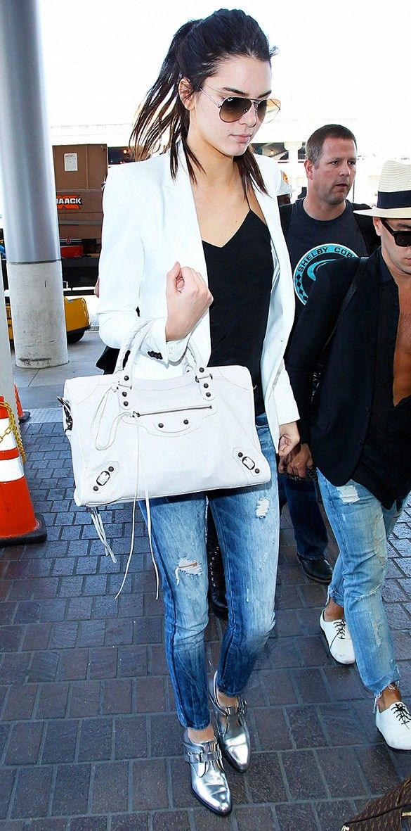 Kendall Jenner's airport outfit is centered around her Barbara Bui Mirror Leather Derby Shoes. That metallic shine makes a serious