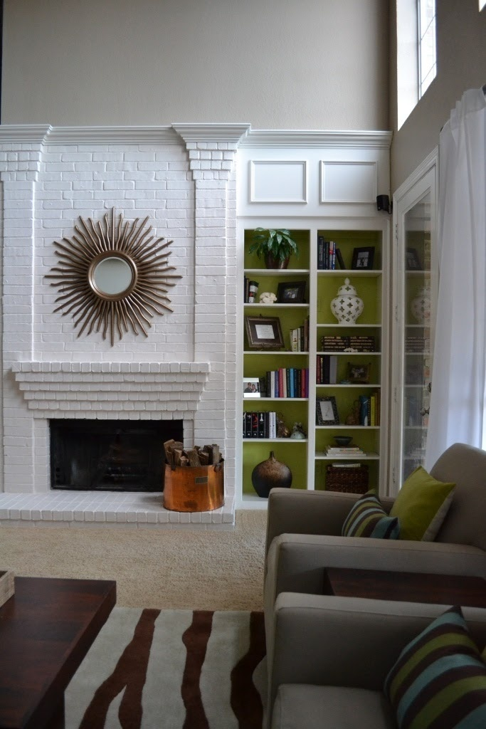Paint the fireplace white and add a color to the back of the book shelves  For the Home