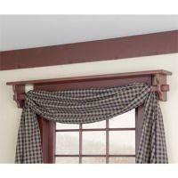 Shelf above window doubles as a curtain rod.