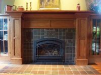 An elaborate Arts and Crafts fireplace surround, with ...
