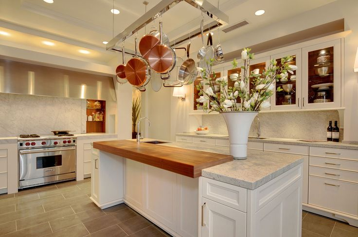 white kitchen island with butcher block top outdoor cabinets stainless steel and quartz countertops. interesting idea for ...