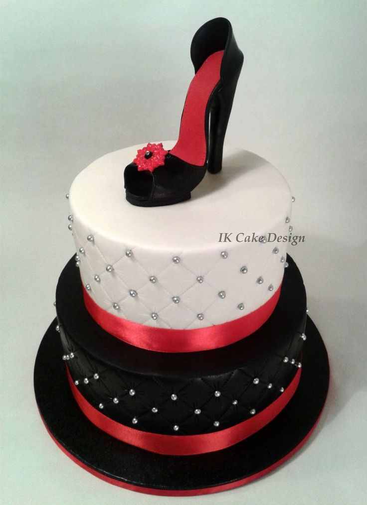 Black And White Quilted Cake Topped With A Red And Black