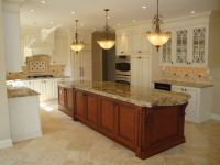 Kitchen with white cabinets and travertine tile floor ...
