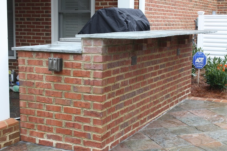 Red Brick Outdoor Kitchen with a Raised Seating Bar
