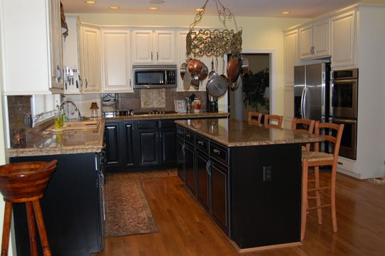 black lower cabinets and black island with white upper