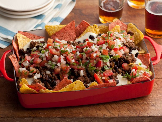 Super Nachos: Rachael tops her Mexican-style meal with traditional nacho fixings, including homemade pico de gallo salsa, made