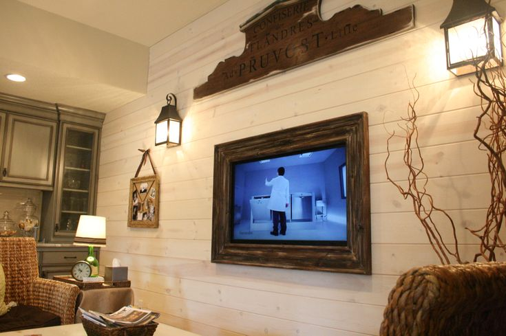 GAH! Barnwood frame for a wall mounted TV. AWESOME.