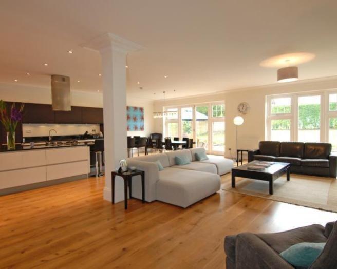 photo of open plan beige orange kitchen kitchendiner