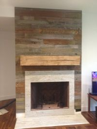 Reclaimed wood fireplace surround and mantel.