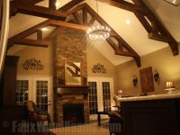 Sandblasted faux wood beams create a beautiful truss that ...