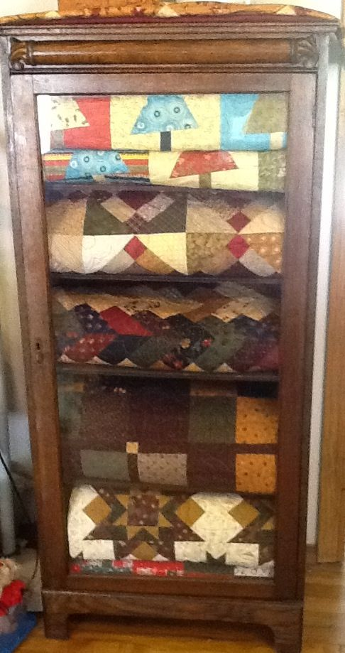My new antique cabinet  filled of course with quilts
