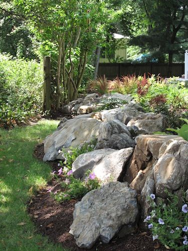 moss rock retaining wall. circle