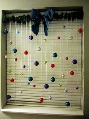I've always wanted to do something like this, but I don't have curtain rods on all my windows. It never occurred to me to use a tension rod. They are pretty cheap and easy to take down after the holiday.: