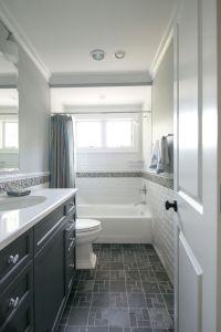 Tiny hall bath, subway tile, dark floors, dark vanity ...