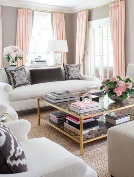 The pink curtains make it a bit girly for me, but I still like the clean lines and brass coffee table.: