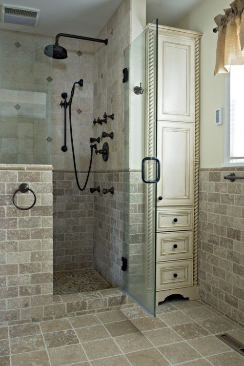 Using every inch of space by putting a tall utility cabinet in the bathroom for linens & such…