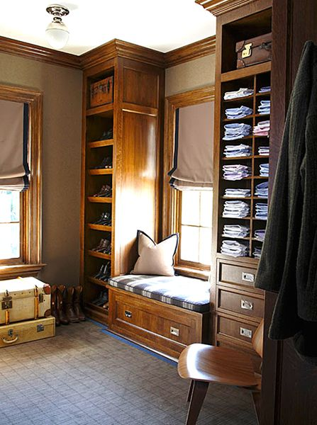 Masculine closet – dark wood – open shelves  cubbies – window seat – Roman shade – Gardiner and Larson Homes