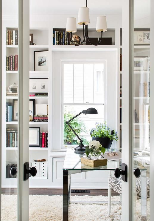 Chic Office Features A Reed Small Chandelier Hangs Over A