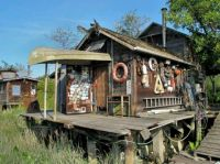 Now that's a fishing shack! Awesome shed idea for a ...