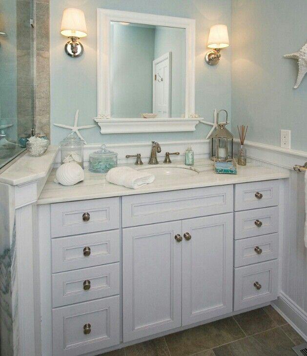 Beach theme bathroom I like the mirror and wall color