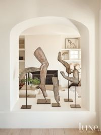 Sculptures in the dining-to-living-room open arch ...