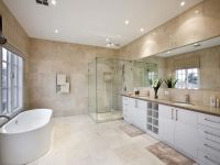 Modern bathroom design with freestanding bath using chrome ...