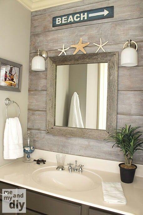 beach theme bathroom  love the drift wood behind the