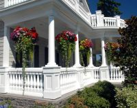 Awesome front porch and beautiful hanging baskets