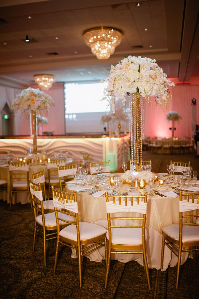 Tall centerpieces in white flowers crystals  gold