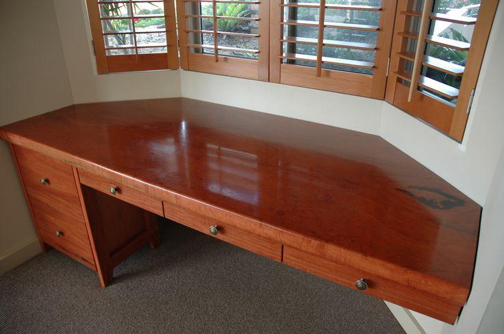 Custom red gum wood bay window desk by Wild Wood Designs