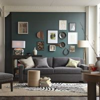 Dark teal colored accent wall in living room, with grey ...