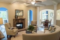Living room with coffered ceiling, arched openings, and ...