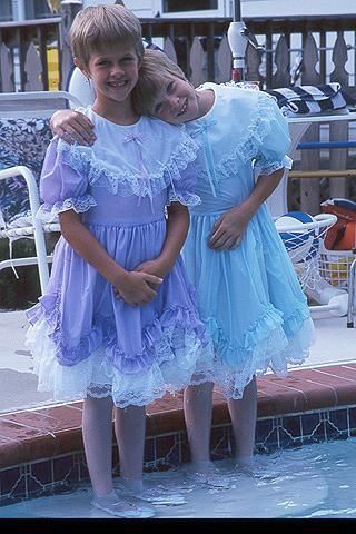 Nice ruffled dresses on those 2 boys They must have a big sister  Crossdressed Youth