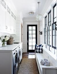 Galley style laundry room with side by side silver front ...