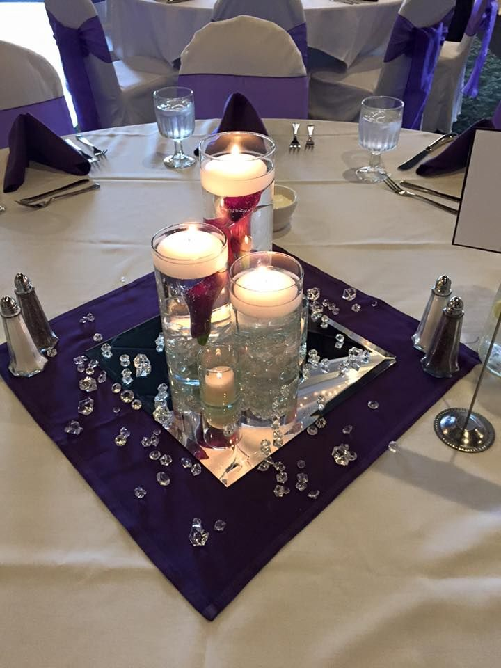 3 tier cylinder vases with submerged purple calla lilies