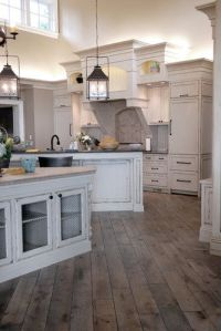 white cabinets, rustic floor, lanterns @ Home Improvement