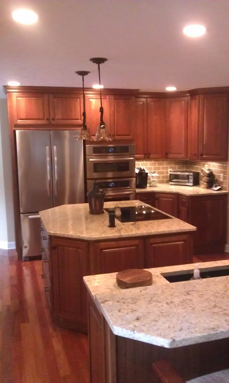 Kitchen cabinet with two Islands Homecrest cabinets