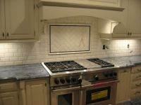 White subway tile 3x6 with chair rail and a blue accent 1 ...