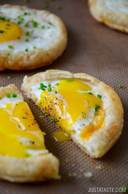 Cheesy Puff Pastry Baked Eggs  – Store-bought puff pastry, eggs, cheddar cheese and chives. The eggs are cooked directly in