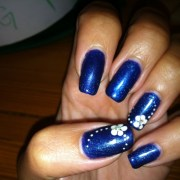 navy blue nails with white flower